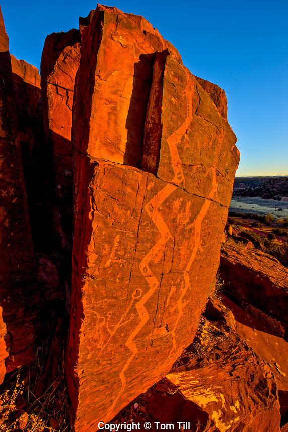 Snake petroglyphs<br /> Rocky Mountains. New Mexico<br /> Sunrise    1,000 + year-old  etchings