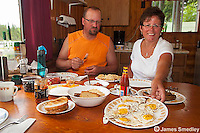Smiling woman hungry man with breakfast