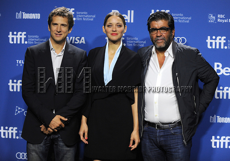 """Director Guillaume Canet, actress Marion Cotillard and producer Alain Attal  attending the 2013 Tiff Film Festival Photo Call for """"Blood Ties""""  at the Tiff Bell Lightbox on September 10, 2013 in Toronto, Canada."""