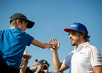 FERNANDO ALONSO (ESP) of McLaren with a young fan during The Formula 1 2018 Rolex British Grand Prix at Silverstone Circuit, Northampton, England on 8 July 2018. Photo by Vince  Mignott.