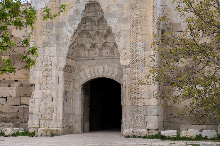 An ornate archway graces a medieval caravanserai where in the past, travelers and their camels spent on the night while traveling on the Silk Road.