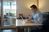 Occidental College student Evan Tolley '15 works over the summer at Strategies 360 in Portland, Oregon as part of the CDC's InternPDX program, Aug. 6, 2013.<br />