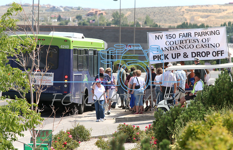 Shuttle buses run from the Fandango to Fuji Park for the NV150 Fair at Fuji Park, in Carson City, Nev., on Saturday, Aug. 2, 2014.<br /> Photo by Cathleen Allison