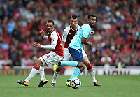 Arsenal's Francis Coquelin and Laurent Koscielny challenge Bournemouth's Joshua King<br /> <br /> Photographer Rob Newell/CameraSport<br /> <br /> The Premier League - Arsenal v AFC Bournemouth - Saturday 9th September 2017 - The Emirates - London<br /> <br /> World Copyright &copy; 2017 CameraSport. All rights reserved. 43 Linden Ave. Countesthorpe. Leicester. England. LE8 5PG - Tel: +44 (0) 116 277 4147 - admin@camerasport.com - www.camerasport.com