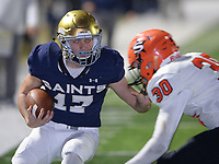 NWA Democrat-Gazette/ANDY SHUPE<br /> Shiloh Christian running back Cam Wiedemann (17) fends off Nashville defender Ty Basiliere Friday, Nov. 29, 2019, during the first half of play at Champions Stadium in Springdale. Visit nwadg.com/photos to see more photographs from the game.