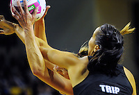 Irene Van Dyk takes a pass under pressure from Joanna Trip during the ANZ Netball Championship match between the Central Pulse and Waikato Bay Of Plenty Magic at TSB Bank Arena, Wellington, New Zealand on Monday, 30 March 2015. Photo: Dave Lintott / lintottphoto.co.nz