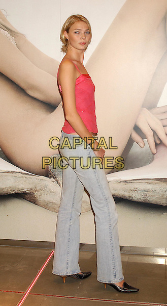 "JODIE KIDD.photocall to announce her second season as face of the ""Create a Storm"" campaign for Monsoon shop  Oxford Street, London.12 February 2004.full length, full-length, bright pink ribbon vest top, denim jeans.sales@capitalpictures.com.www.capitalpictures.com.©Capital Pictures"
