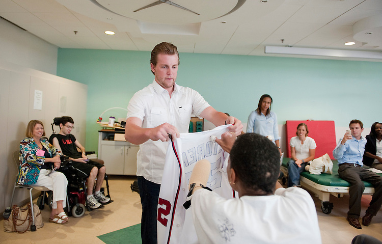 UNITED STATES - AUGUST 19:  Drew Storen, Washington Nationals relief pitcher, gives his jersey to a patient during a therapeutic recreation group at the National Rehabilitation Hospital.  Storen visited the facility to participate in activities which are often used in patient's rehabilitation.  (Photo By Tom Williams/Roll Call)