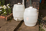 Two white plastic pressure barrels for beer home brewing, UK