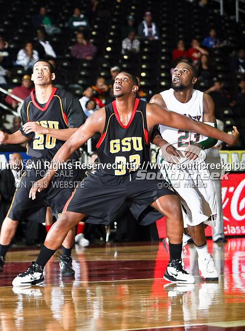 Grambling State Tigers forward Chris Britt-Black (33), Grambling State Tigers forward Lance Feurtado (20) and Mississippi Valley State Delta Devils forward Falando Jones (23) in action during the SWAC Tournament game between the Grambling State Tigers and the Mississippi Valley State Delta Devils at the Special Events Center in Garland, Texas. Grambling State defeats Mississippi Valley 65 to 62
