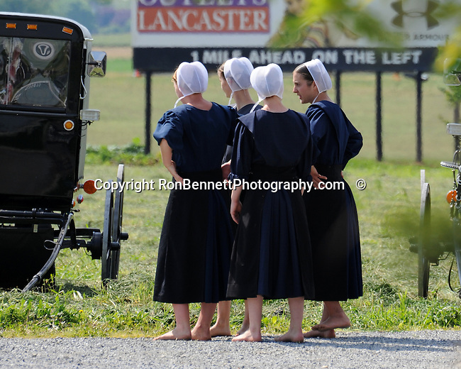 "Bare foot Amish girls talk in Pennsylvania Dutch Amish country in Lancaster County PA,Pennsylvania Dutch in Amish Country Lancaster County Pennsylvania, Amish, Horse and buggy with amish family on backroads of Pennsylvainia, buggy, amish family, buggy and horse, Commonwealth of Pennsylvania, Commonwealth of Pennsylvania, natives, Northeasterners, Middle Atlantic region, Philadelphia, Keystone State, 1802, Thirteen Colonies, Declaration of Independence, State of Independence, Liberty, Conestoga wagons, Quaker Province, Founding Fathers, 1774, Constitution written, Photography history, Fine art by Ron Bennett Photography.com, Stock Photography, Fine art Photography and Stock Photography by Ronald T. Bennett Photography ©, All rights reserved copyright Ron Bennett Photography.Com, FINE ART and STOCK PHOTOGRAPHY FOR SALE, CLICK ON  ""ADD TO CART"" FOR PRICING,"