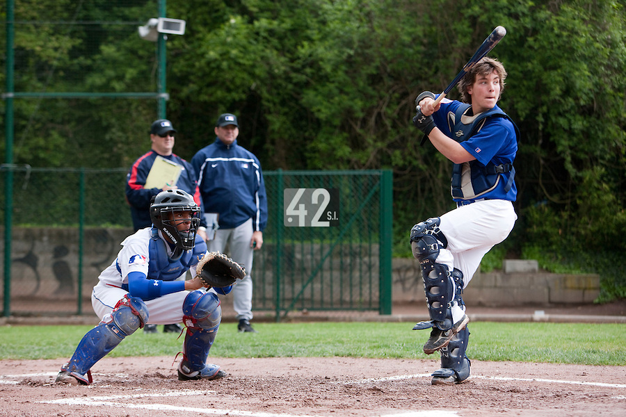 29 April 2009: Andy Paz is seen catching as Tom Mayeux poses during the first of six 2009 MLB European Academy Try-out Sessions throughout Europe, at Stade Pierre Rolland, in Rouen, France. Try-out sessions are run by members of the Major League Baseball Scouting Bureau with assistance from MLBI staff.