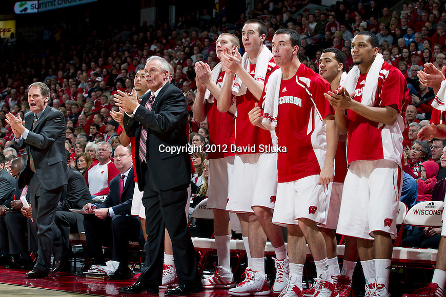 Wisconsin Badgers Head Coach Bo Ryan and his team cheer during a game against the Northwestern Wildcats during a Big Ten Conference NCAA college basketball game on January 18, 2012 in Madison, Wisconsin. The Badgers won 77-57. (Photo by David Stluka)
