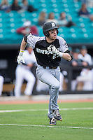 Jacob Marotta (29) of the Bryant Bulldogs hustles down the first base line against the Coastal Carolina Chanticleers at Springs Brooks Stadium on March 13, 2015 in Charlotte, North Carolina.  The Chanticleers defeated the Bulldogs 7-2.  (Brian Westerholt/Four Seam Images)