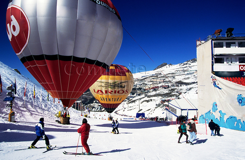 Hot air balloons preparing for take off from a ski resort