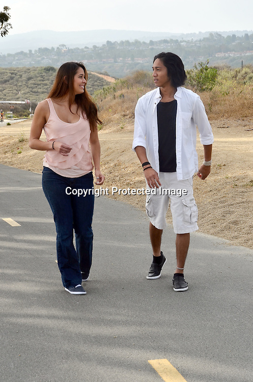 Stock photo of young couple walking and hiking