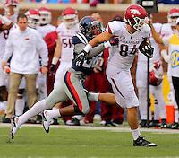 11/7/15<br /> Arkansas Democrat-Gazette/STEPHEN B. THORNTON<br /> Arkansas' Hunter Henry pulls  Ole Miss' Zedrick Woods downfield during the second quarter of Saturday's game in Oxford, Miss.