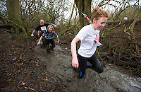 06 FEB 2011 - SIBBERTOFT, GBR - Laura Malins wades through the brook during the Avalanche Adventure Run .(PHOTO (C) NIGEL FARROW)