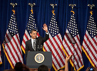 President Barack Obama waves goodbye after delivering a plan that will help keep Americans out of financial crisis and avoid home foreclosure at Dobson High School in Mesa, Arizona, February 18, 2009.