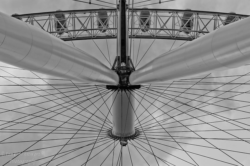 Looking up at the spokes in the London Eye in B&W