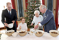 21/12/2019 - Undated photograph released by Buckingham Palace of Queen Elizabeth II, Prince Charles Prince of Wales, Prince William Duke of Cambridge and Prince George preparing special Christmas puddings in the Music Room at Buckingham Palace, London, as part of the launch of The Royal British Legion's Together at Christmas initiative. Photo Credit: ALPR/AdMedia