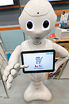 A SoftBank's humanoid robot Pepper shows on its screen a payment application for convenience stores during SoftBank Robot World 2017 on November 21, 2017, Tokyo, Japan. SoftBank Robotics organized SoftBank Robot World 2017 to introduce AI (Artificial Intelligence) and IoT (the Internet of Things) companies developing the latest technology for robots, including applications its humanoid robot Pepper in various business fields. The robot expo runs until November 22. (Photo by Rodrigo Reyes Marin/AFLO)