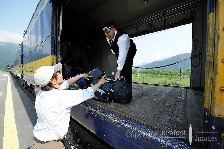 Georgia Bennett hands her pack to brakeman Tony xxx. The Alaska Railroad's Spencer Glacier Whistlestop train gives visitors access to hiking, camping and stunning views.