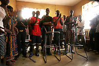 Youths, chained to chair frames take part in a religious service in the 'City of Rest', a rudimentary counselling and mini rehabilitation centre for recovering drug addicts, alcoholics and traumatised or delinquent youths.  It is run by a pastor who attributes the centre's success to extensive rest, food and prayer.