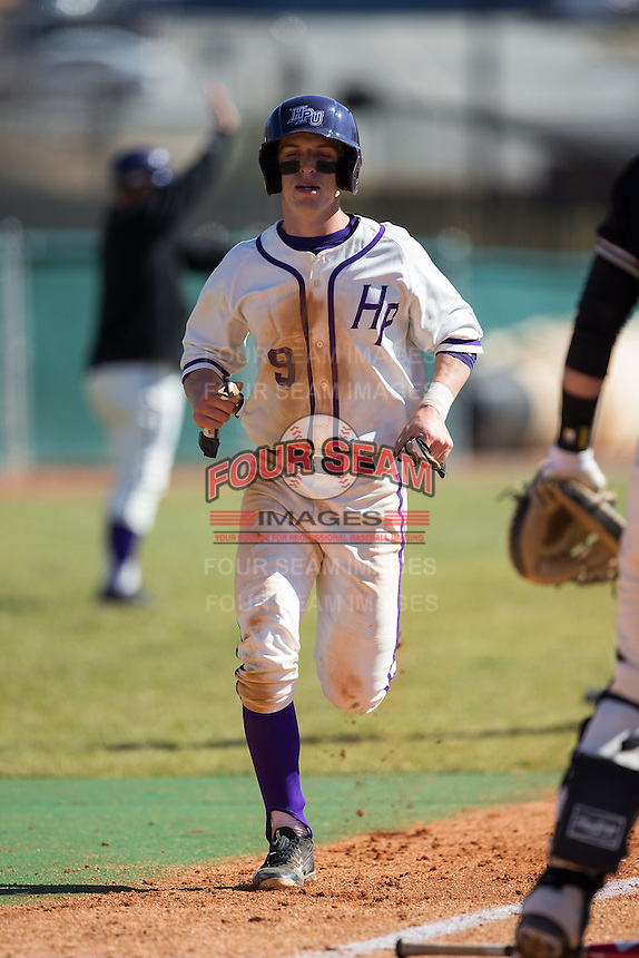 Chris Clare (9) of the High Point Panthers scores a run against the LIU-Brooklyn Blackbirds at Willard Stadium on March 8, 2015 in High Point, North Carolina.  The Panthers defeated the Blackbirds 9-0.  (Brian Westerholt/Four Seam Images)
