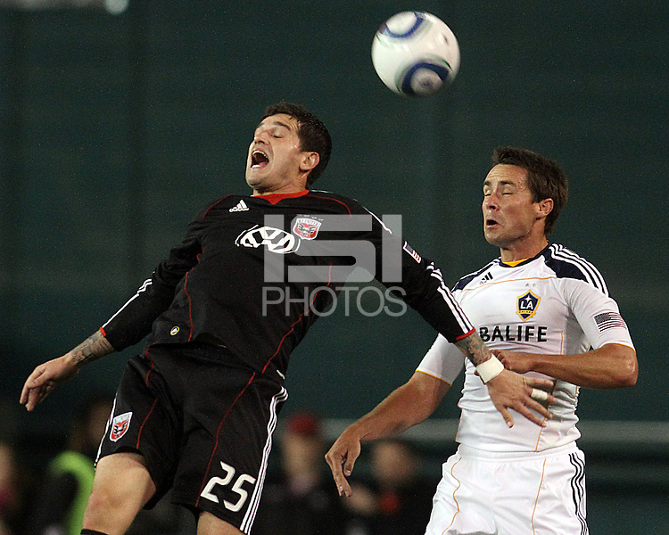 Santino Quaranta (25) of D.C. United heads over Todd Dunivant (2) of the Los Angeles Galaxy during an MLS match at RFK Stadium, on April 9 2011, in Washington D.C.The game ended in a 1-1 tie.
