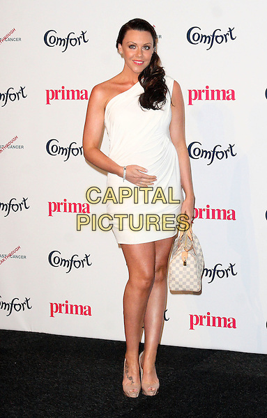 MICHELLE HEATON.Prima High Street Fashion Awards, Battersea Evolutions, Battersea Park, London, England..September 8th, 2011.full length white one shoulder dress pregnant bag purse .CAP/JIL.©Jill Mayhew/Capital Pictures