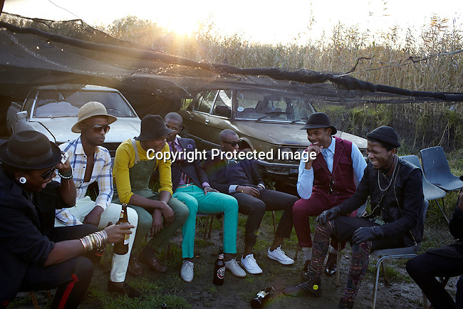 SOWETO, SOUTH AFRICA MAY 21: Sibu Sithole (l), a young designer part of the group Smarteez with models and his his colleagues on May 21, 2013 in Kliptown section of Soweto, South Africa. They did a photo shoot together with a new collection. Soweto today is a mix of old housing and newly constructed townhouses. A new hungry black middle-class is growing steadily. Many residents work in Johannesburg but the last years many shopping malls have been built, and people are starting to spend their money in Soweto. (Photo by: Per-Anders Pettersson)