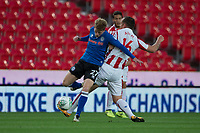 Andy Cannon of Rochdale tangles with Charlie Adam of Stoke City during the Carabao Cup match between Stoke City and Rochdale at the Britannia Stadium, Stoke-on-Trent, England on 23 August 2017. Photo by James Williamson / PRiME Media Images.