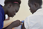 Rebecca Nyibeny Monday gives an injection in the clinic of the Loreto School outside Rumbek, South Sudan. The school is run by the Institute for the Blessed Virgin Mary--the Loreto Sisters--of Ireland. Monday, an intern in the clinic, is a graduate of the Loreto Girls Secondary School.