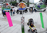 A toddler sleeps in a stroller in front of a display of Edo furin, or glass wind chimes, at a main junction in the Ginza district of Tokyo, Japan. The traditional chimes, which were until not long ago carried around town by sellers on bamboo poles, date back more than 200 years in Japan. Today there are but a handful of makers left in Japan, with cheaper imports from Korea and China gaining the lion's share of the business for these popular summer decorations. Shinohara' Furinhonpo has been in operation for over 100 years. The family-run business makes around 200,000 of the chimes a year.