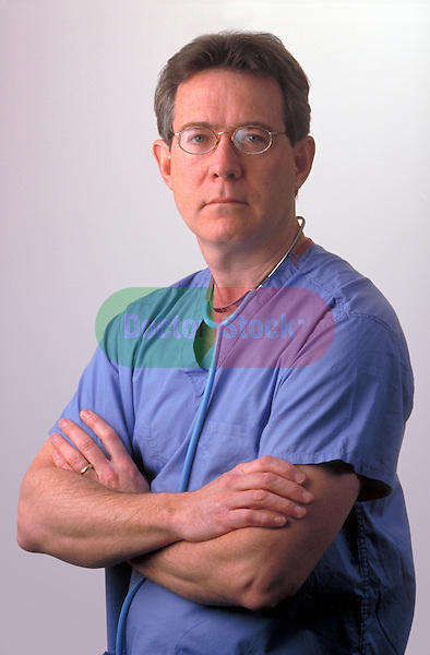 portrait of serious doctor with arms folded