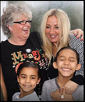 BNPS.co.uk (01202 558833)<br /> Pic:  BNPS<br /> <br /> Grandmother Maxine Horton with daughter Miranda and her children Qisara(8) and Zavian(10)<br /> <br /> A grandmother who was fined £100 for staying in a fast food restaurant car park for 18 minutes too long has won her appeal.<br /> <br /> Maxine Horton was penalised after parking for one hour and 18 minutes outside a KFC in Poole, Dorset, when she took her grandchildren there for a treat meal.<br /> <br /> The parking penalty from Euro Car Parks stated she had been in contravention of the Wessex Gate retail park's car park one hour limit.<br /> <br /> But it has now been quashed after Mrs Horton wrote to the head of KFC to tell him it was 'virtually impossible' to get a group of children to pick a meal, eat it and use the toilets in that restricted timeframe.