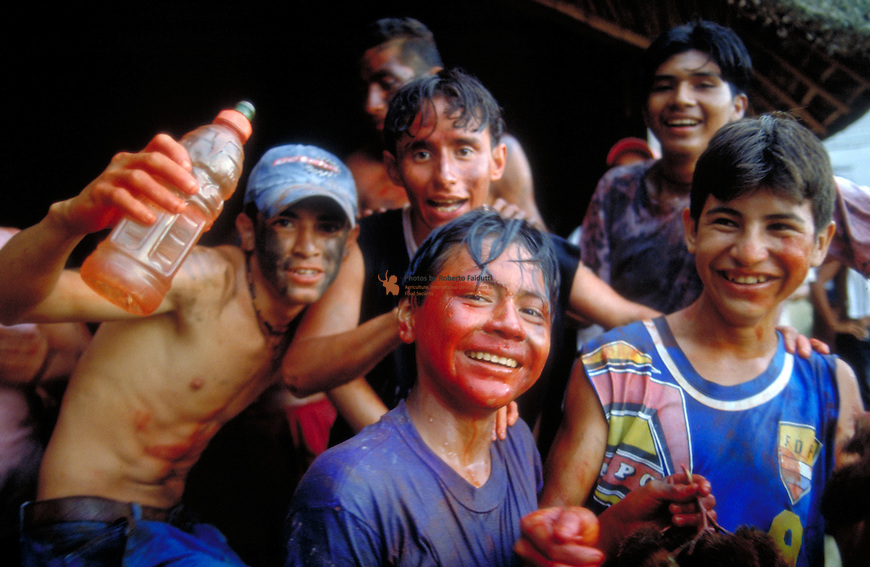 Boys painting their face using Bixa oreillana