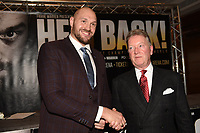Tyson Fury (L) and Frank Warren during a Press Conference at the Four Seasons Hotel on 12th April 2018