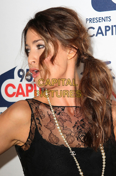 LISA SNOWDON .Capital Rocks at the Battersea Evolution, London, England, December 2nd 2008..portrait headshot black lace dress pearl necklace Chanel profile ponytail funny sheer see thorough thru  .CAP/JIL.©Jill Mayhew/Capital Pictures