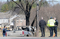 NWA Democrat-Gazette/DAVID GOTTSCHALK Emergency personnel continue to document the scene Thursday, March 8, 2018, of a double fatal accident near North Bloomington Street and School Avenue in Lowell. Lt. Paul Pillaro, public information officer with Lowell Police, said the vehicle was traveling northbound crossed southbound traffic, hit a tree and caught fire Thursday morning.