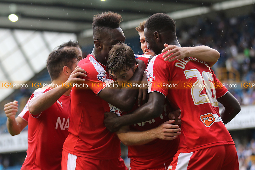 Chesterfield players celebrate and hug, Jay O'Shea, after he scored their second goal during Millwall vs Chesterfield, Sky Bet League 1 Football at The Den, London, England on 29/08/2015