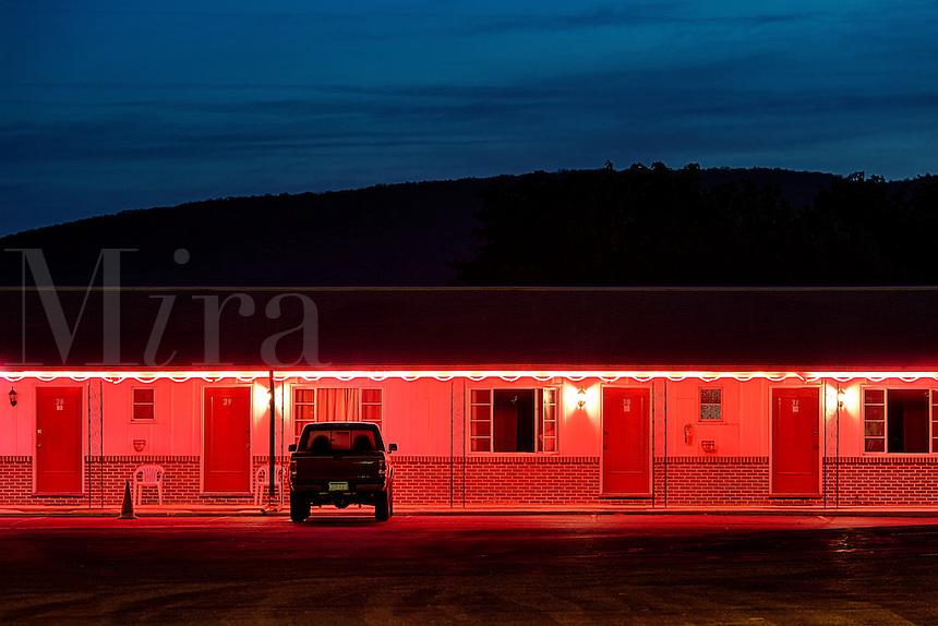 Budget motel exterior at dusk.
