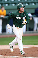 Designated hitter Andrew Morrow (14) of the Michigan State Spartans runs out a batted ball in a game against the Merrimack Warriors on Saturday, February 22, 2020, at Fluor Field at the West End in Greenville, South Carolina. Merrimack won, 7-5. (Tom Priddy/Four Seam Images)