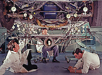 Ford test engineers take readings on a car chassis to detect metal fatigue. Ford Motor Company, Dearborn Michigan, 1966. Photo by John G. Zimmerman.