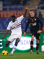 Calcio, ottavi di finale di Coppa Italia Tim: Roma vs Sampdoria. Roma, stadio Olimpico, 9 gennaio 2014.<br /> Sampdoria midfielder Pedro Obiang of Spain is challenged by AS Roma midfielder Rodrigo Taddei, of Brazil, right, during the Italy Cup round of sixteen football match between AS Roma and Sampdoria at Rome's Olympic stadium, 9 January 2014.<br /> UPDATE IMAGES PRESS/Isabella Bonotto