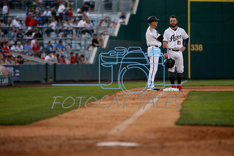 Reno Aces Coach Greg Gross takes with Wyatt Mathisen during a game against the Sacramento River Cats in Reno, Nev., on Thursday, July 4, 2019.<br /> Photo by Cathleen Allison/Nevada Momentum