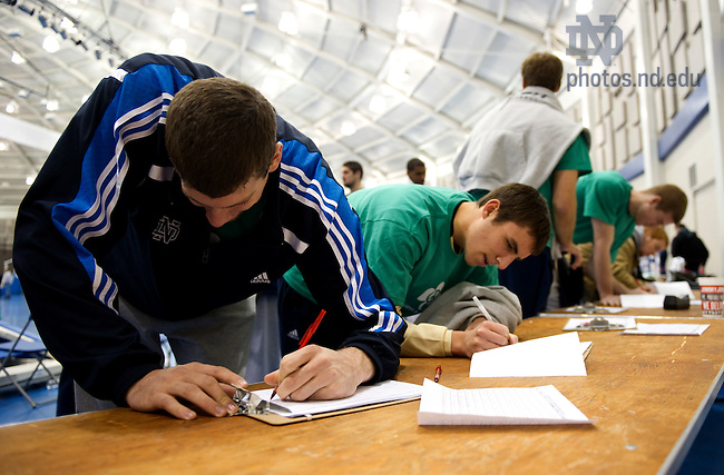 "Dec. 4, 2010; Members of the Men's Basketball sign petitions urging action after the ""Stand With Sudan Peace Rally"" at the Joyce Center fieldhouse...Photo by Matt Cashore/University of Notre Dame"