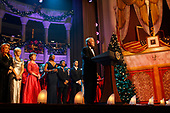 United States President George W. Bush speaks at the annual Ford's Theatre Gala in Washington, DC, which is being taped now for a Christmastime airing on June 24, 2007. Those pictured behind the President, from left, include singers, Winona Judd, Olivia Newton-John, first lady Laura Bush, singers Yolanda Adams, Jon Secada and Dancing with the Stars' Jonathan Roberts. <br /> Credit: Chris Maddaloni / Pool via CNP