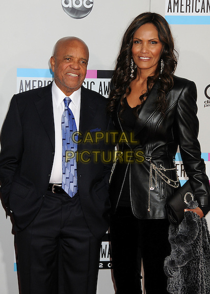 Berry Gordy & guest.2011 American Music Awards - Arrivals held at Nokia Theatre LA Live, Los Angeles, California, USA..November 20th, 2011.ama amas ama's half length suit jacket leather blue tie black white stubble facial hair .CAP/ADM/BP.©Byron Purvis/AdMedia/Capital Pictures.